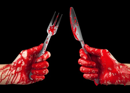 A bloody pair of hands holding a knife and fork isolated on black.
