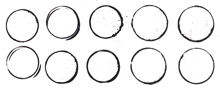 10 mug stain rings done with black ink/paint.