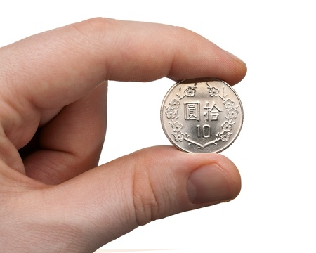 10 fingers: A male thumb and index finger gripping a New Taiwan 10 Dollar Coin.