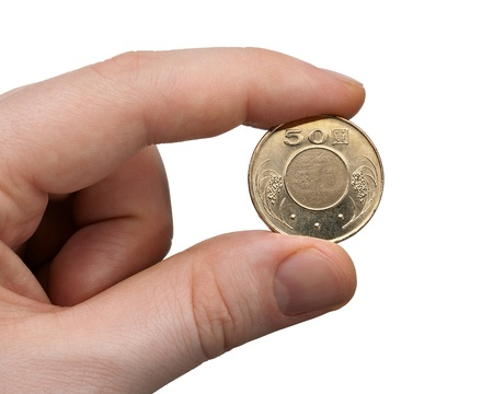A male thumb and index finger gripping a New Taiwan 50 Dollar Coin.