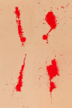bloodstain: Composite of 4 redblood stains and spatter on brown cardboard. Stock Photo