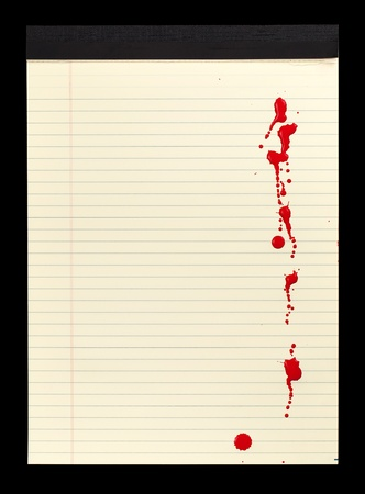 bloodstains: A sheet of lined yellow notepad paper with red blood stains (paint) on it.