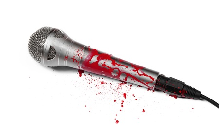 A blood covered microphone isolated on white.