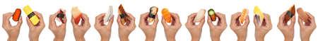 14 hands holding various kinds of sushisashimi isolated on white. photo