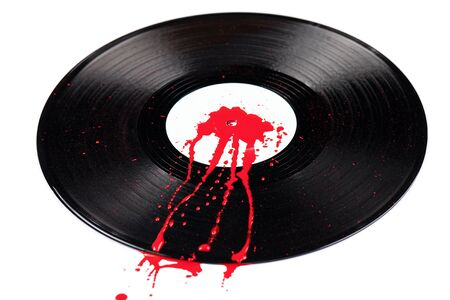 bloodstain: A 12 inch vinyl record with blood spatter on it isolated on white