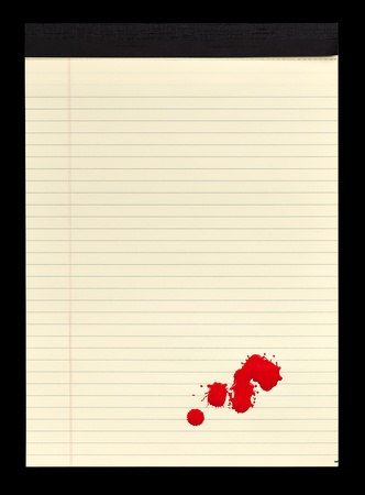 A sheet of lined yellow notepad paper with red blood stains  paint  on it  photo