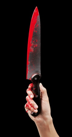 A bloody hand holding a large blood covered knife on a black isolated background