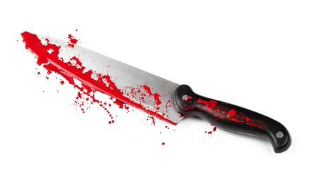 A blood covered knife isolated on white  photo