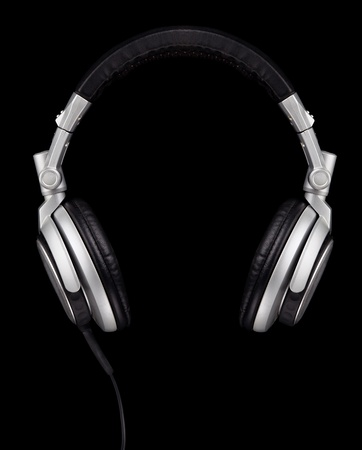 equipment: A pair of DJ style headphones isolated on black  Stock Photo