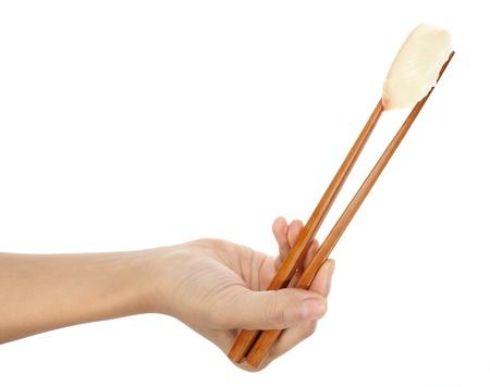 A piece of sushi made with tilapia (izumi dai). photo