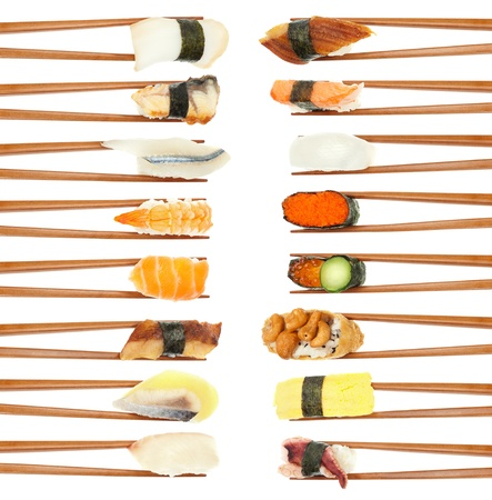 fish type: 16 different types of sushi being held up in in two vertical rows with wooden chopsticks isolated on white.
