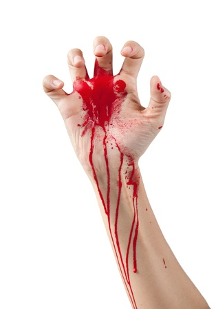 A red paint covered hand reaching out isolated on white.