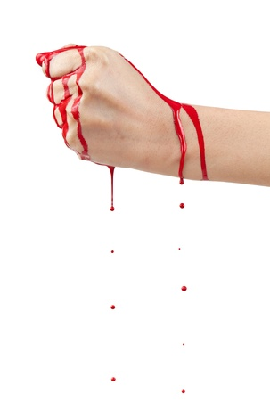 A bloody hand making a fist with blood dripping down isolated on white.