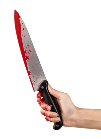 bloodstains: A hand holding a large blood covered knife on a white isolated background. Stock Photo