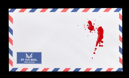 A white air mail envelope with a some blood stains on it  photo