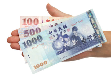 A hand holding a 100, 500 and 1000 New Taiwan Dollar bill