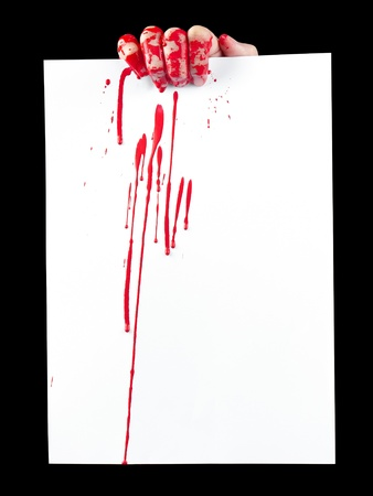 A blood covered hand holding up a piece of blood covered white paper isolated on black.