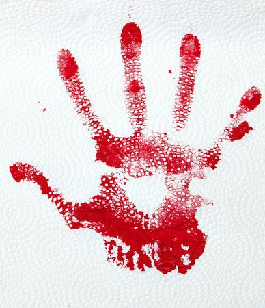 smeared: A red hand print on textured paper towlel.