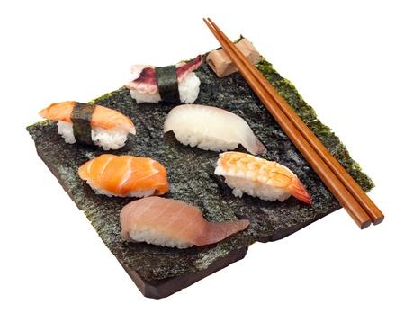 6 pieces of sushisashimi on a sheet of seaweed. photo
