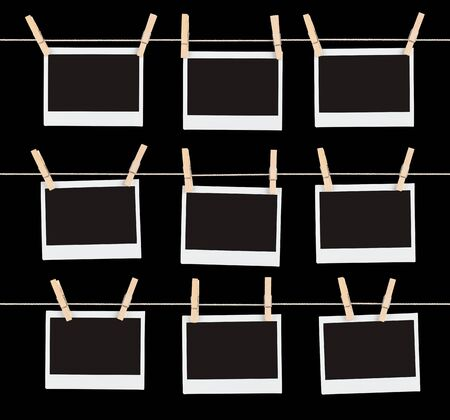 Three rows of three blank pieces of instant film held on strings with  clothespins isolated on black. photo