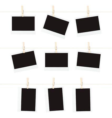 Three rows of three blank pieces of instant film hanging from clothespins on strings isolated on white