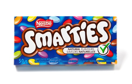 nestle: Toronto, Canada - May 8, 2012: This is a studio shot of Smarties candy coated milk chocolate made by Nestle isolated on a white background. Editorial