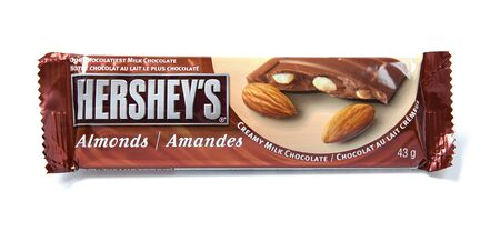 hersheys: Toronto, Canada - May 8, 2012: This is a studio shot of Hersheys Almonds creamy milk chocolate made by Hersheys isolated on a white background. Editorial