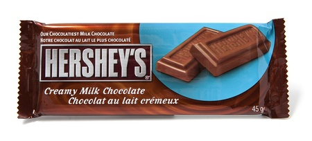 Toronto, Canada - May 8, 2012: This is a studio shot of Hershey's Creamy Milk Chocolate made by Hershey's isolated on a white background. Editorial