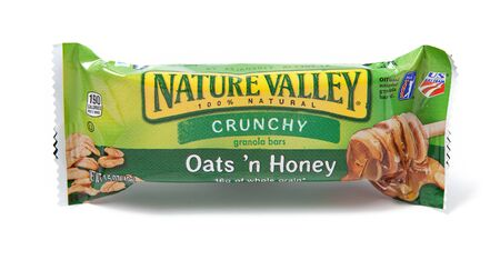 cereal bar: Toronto, Canada - May 8, 2012: This is a studio shot of Nature Valley Crunchy granola bars made by General Mills, Inc. isolated on a white background.