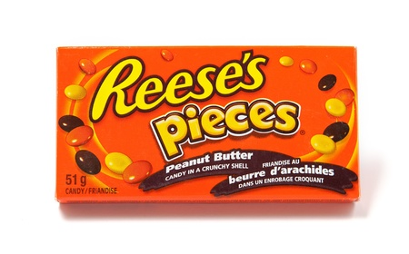 hershey's: Toronto, Canada - May 8, 2012: This is a studio shot of Reeses Pieces peanut butter candy made by Reese, a subsidiary of The Hershey Company, isolated on a white background.