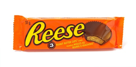 Toronto, Canada - May 8, 2012: This is a studio shot of Reese Peanut Butter Cups candy made by Reese, a subsidiary of The Hershey Company, isolated on a white background. Stock Photo - 14444015