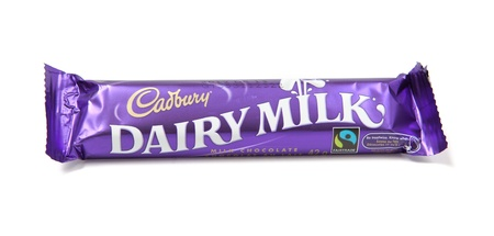 Toronto, Canada - May 8, 2012: This is a studio shot of Dairy Milk chocolate candy made by Cadbury isolated on a white background.