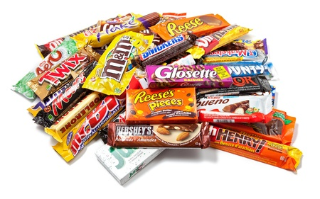 Toronto, Canada - May 8, 2012: This is a studio shot of a variety of chocolate products made by various companies including Nestle, Hershey
