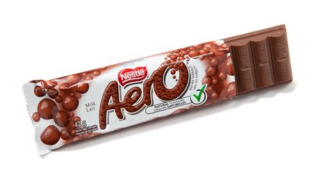 nestle: Toronto, Canada - May 10, 2012: This is a studio shot of Aero milk chocolate candy made by Nestle isolated on a white background.