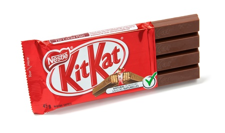 nestle: Toronto, Canada - May 10, 2012: This is a studio shot of KitKat wafer bar candy made by Nestle isolated on a white background. Editorial