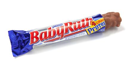 unwrapped: Toronto, Canada - May 10, 2012: This is a studio shot of Baby Ruth candy made by Nestle isolated on a white background.