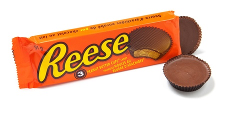 Toronto, Canada - May 10, 2012: This is a studio shot of Reese Peanut Butter Cups candy made by Reese, a subsidiary of The Hershey Company, isolated on a white background. Editorial