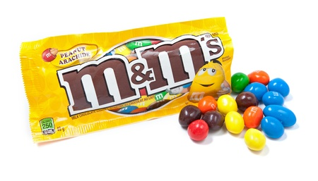 mars incorporated: Toronto, Canada - May 10, 2012: This is a studio shot of M&Ms milk chocolate candies made by Mars, Incorporated isolated on a white background.