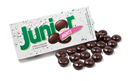 chocolate mint: Toronto, Canada - May 10, 2012: This is a studio shot of a box of Junior Mints made by Tootsie Roll Industries isolated on a white background.