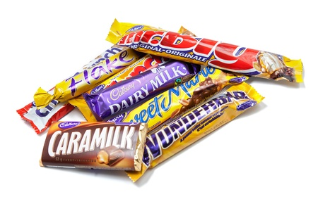 Toronto, Canada - May 8, 2012: This is a studio shot of a variety of Cadbury chocolate products isolated on a white background. Stock Photo - 14444049
