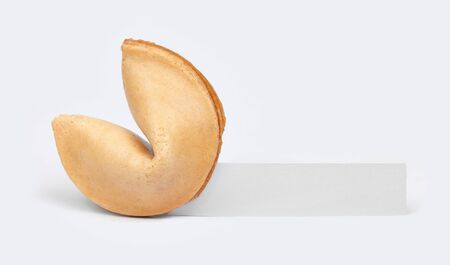 fortune cookie: A fortune cookie with a blank piece of paper.