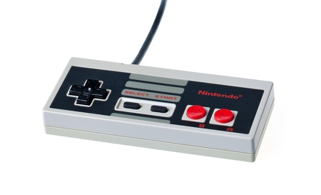nintendo: Taipei, Taiwan - July 4, 2012: This is a studio shot of a Nintendo Entertainment System controller made by Nintendo Co. isolated on a white background.