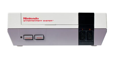 nintendo: Taipei, Taiwan - July 4, 2012: This is a studio shot of a Nintendo Entertainment System also known as NES made by the Nintendo Co. isolated on a white background. Editorial