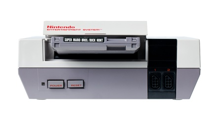 Taipei, Taiwan - July 4, 2012: This is a studio shot of a Nintendo Entertainment System including a Super Mario Bros. and Duck Hunt cartridge, made by Nintendo Co. isolated on a white background.