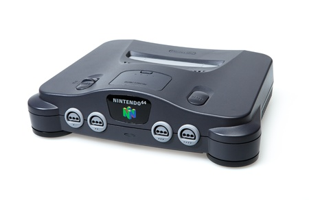 Toronto, Canada - September 10, 2012: This is a studio shot of a Nintendo 64 game console isolated on a white background.