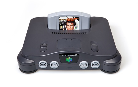 nintendo: Toronto, Canada - September 10, 2012: This is a studio shot of a Nintendo 64 game console and Goldeneye 007 game isolated on a white background.