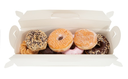 An open white box contaning various donuts isolated on white. photo