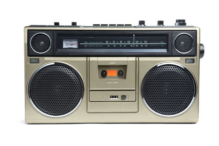 hiphop: A stylish bronze boombox radio from the 1970s isolated on white.