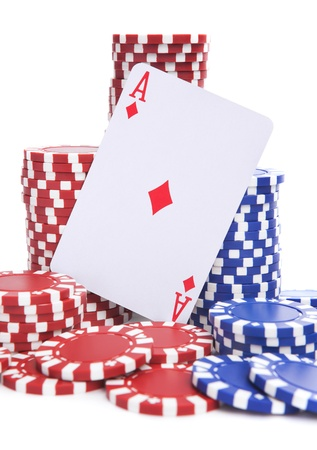 atop: An ace of diamonds atop a pile of red and blue poker chips on a white background.