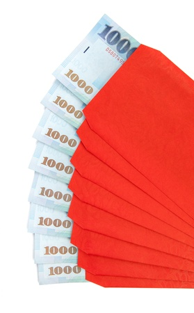 nt: A fan of red envelope with 1000 New Taiwan dollar notes in each of them isolated on a white background. Stock Photo